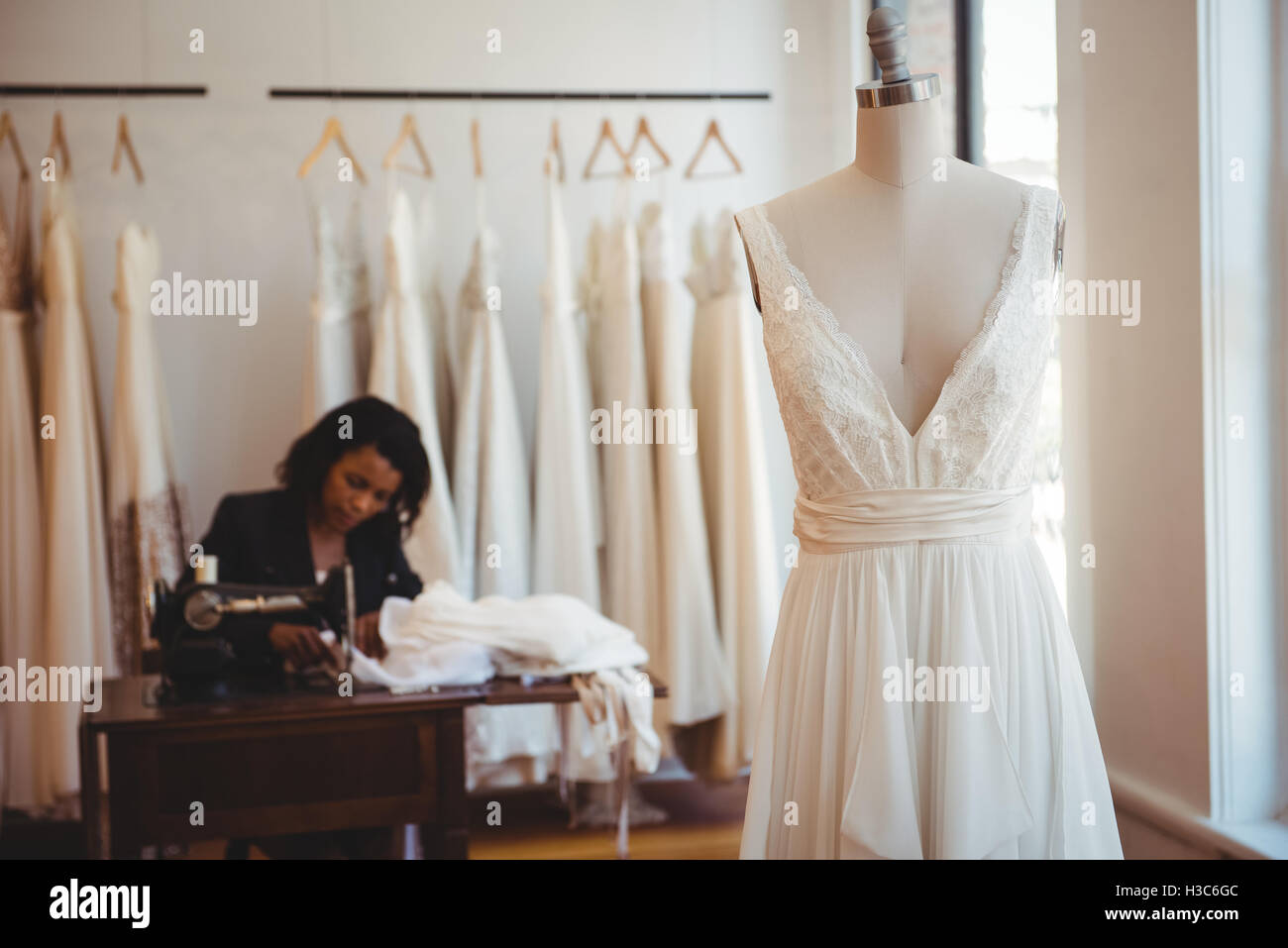 Couture hanging on mannequin - Stock Image