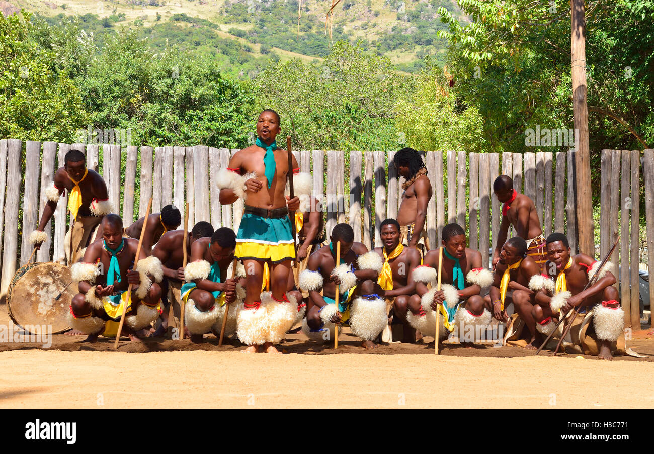 Swazi dance troupe in traditional clothes chanting singing and dancing at Mantenga Cultural Village,  Ezulwini Valley,Swaziland Stock Photo