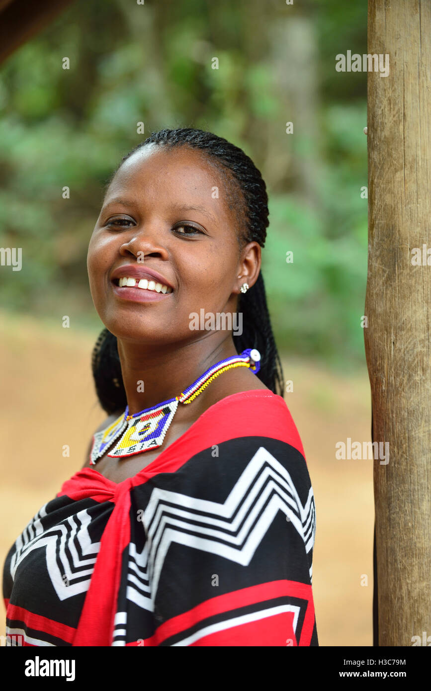 Swazi girl in traditional clothes strikes the pose at Mantenga Cultural Village,  Ezulwini Valley , Swaziland - Stock Image