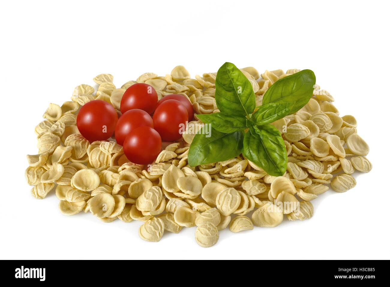 Orecchiette tomatoes and basil isolated on white Stock Photo