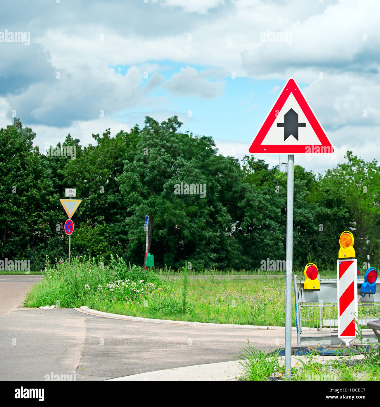 warning road sign at the intersection of roads - Stock Image