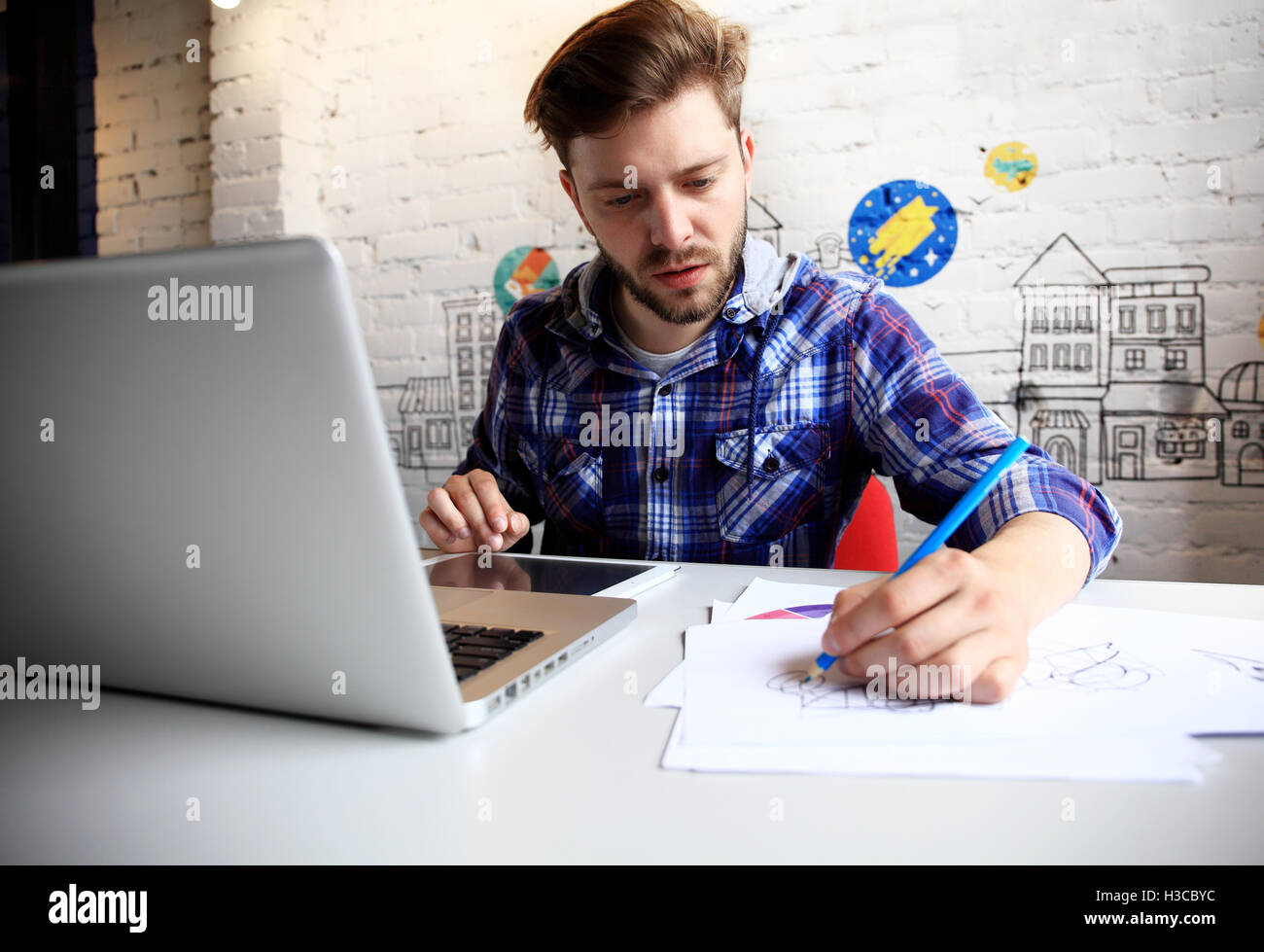 Photo young and talente finance manager working with new project. Handsome man working from his home office. Analyze - Stock Image