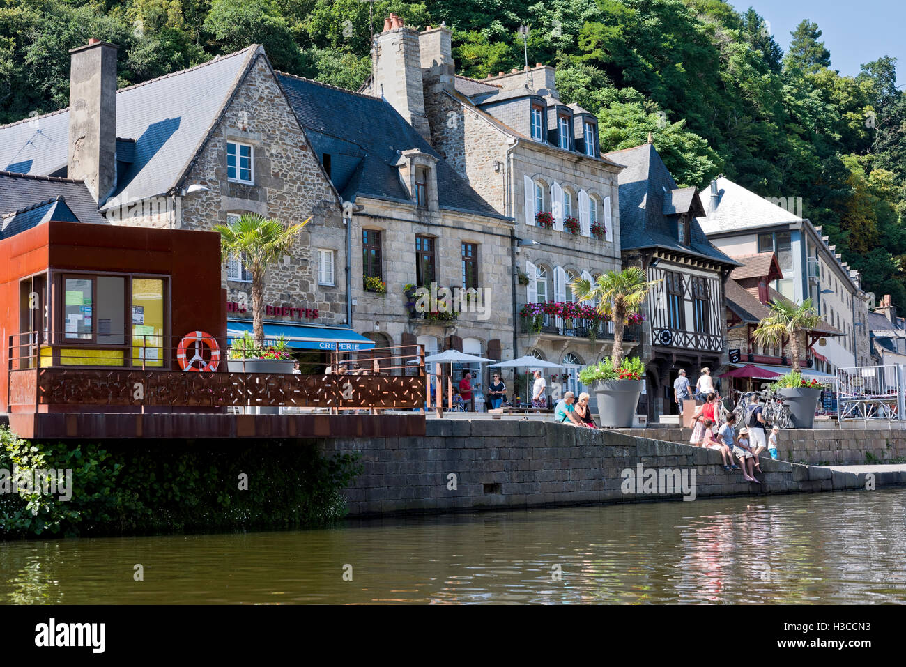 alfresco dining on the banks of the River Rance at Dinan Brittany Stock Photo
