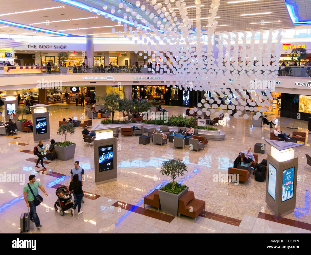 People, shops and restaurants in Maynard H Jackson Jr terminal on Hartsfield Jackson International airport in Atlanta, - Stock Image