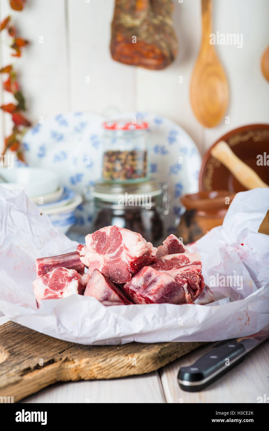 Raw and fresh oxtail on the table of the kitchen ready to be cooked - Stock Image