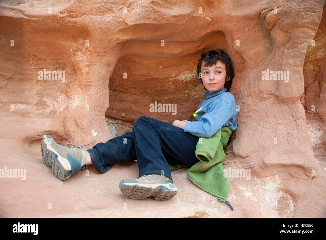 Boy relaxing on rock formation at Capitol Reef National Park, Utah, USA - Stock Image