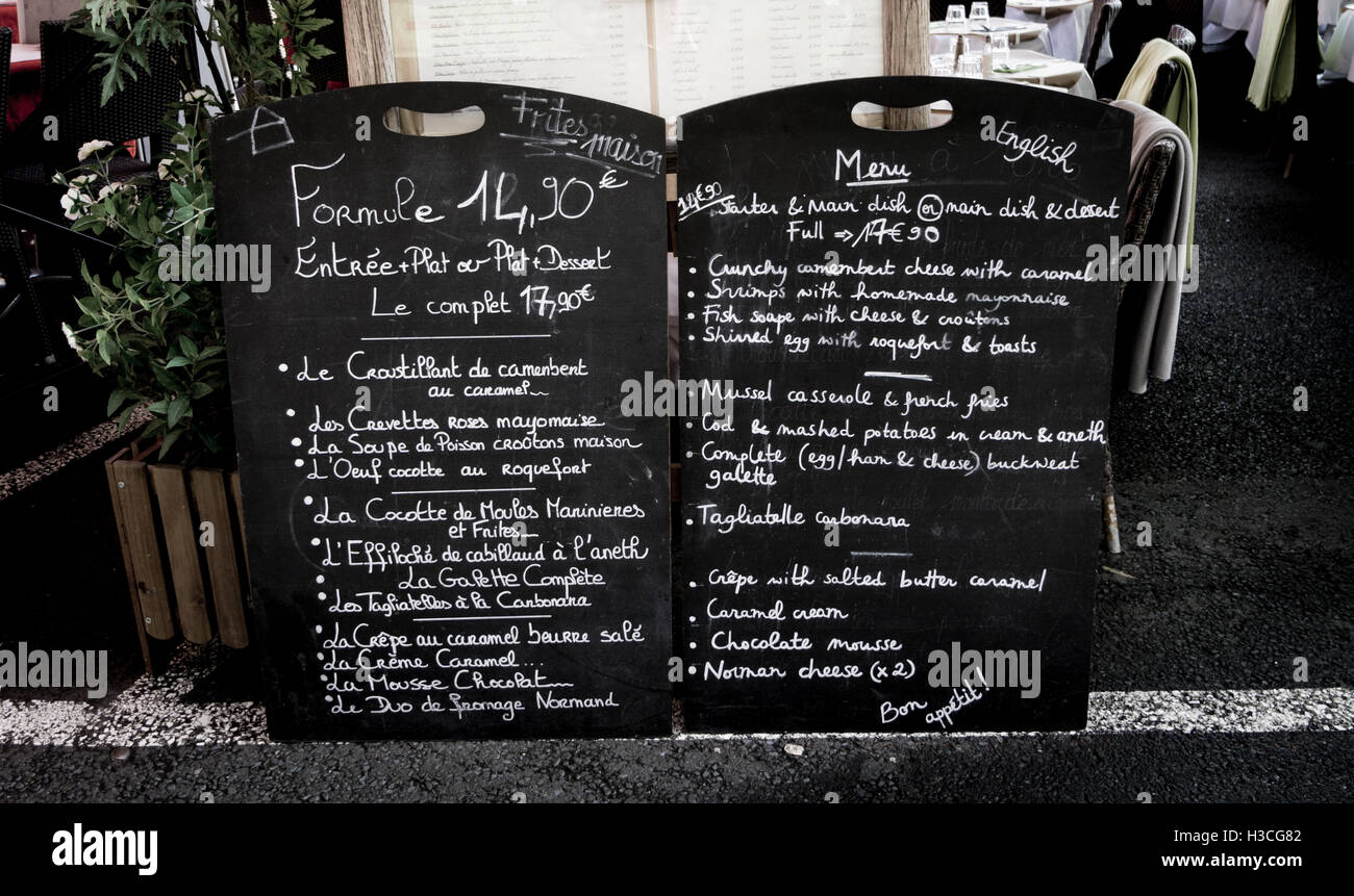 A bilingual menu on blackboards in French and English - Stock Image