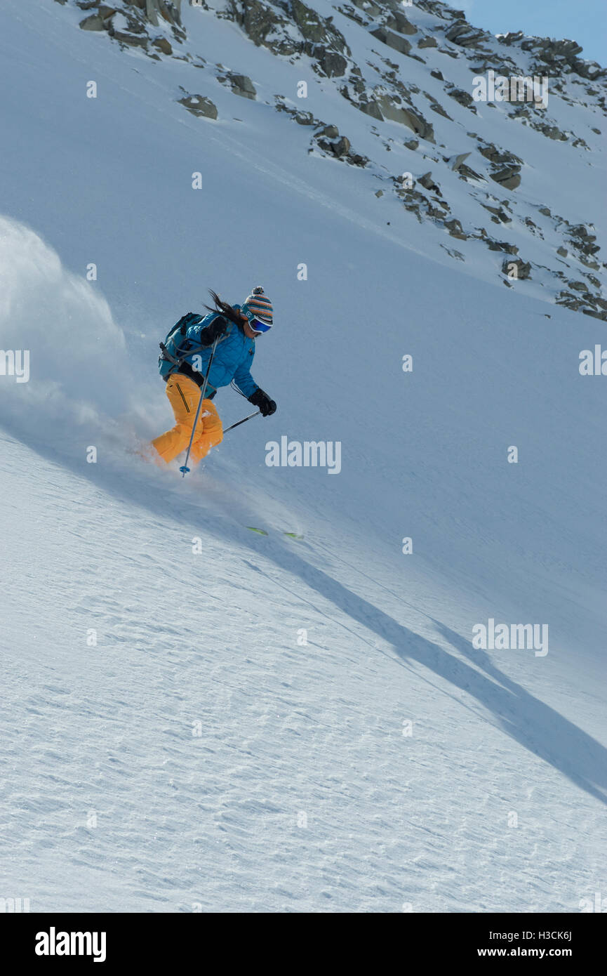 Freeride skier on a fresh powder slope - Stock Image
