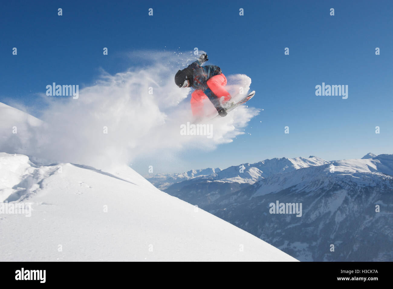 Jump with a snowboard with a grab - Stock Image