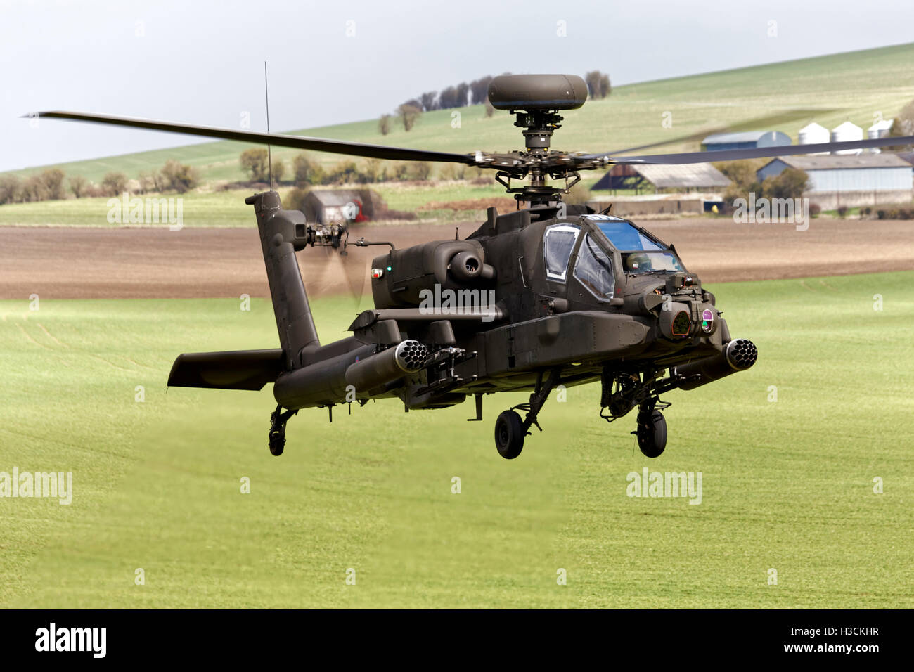 A British Army Air Corps AugustaWestland Apache AH1 Helicopter flying over the Salisbury Plain Training Area in - Stock Image