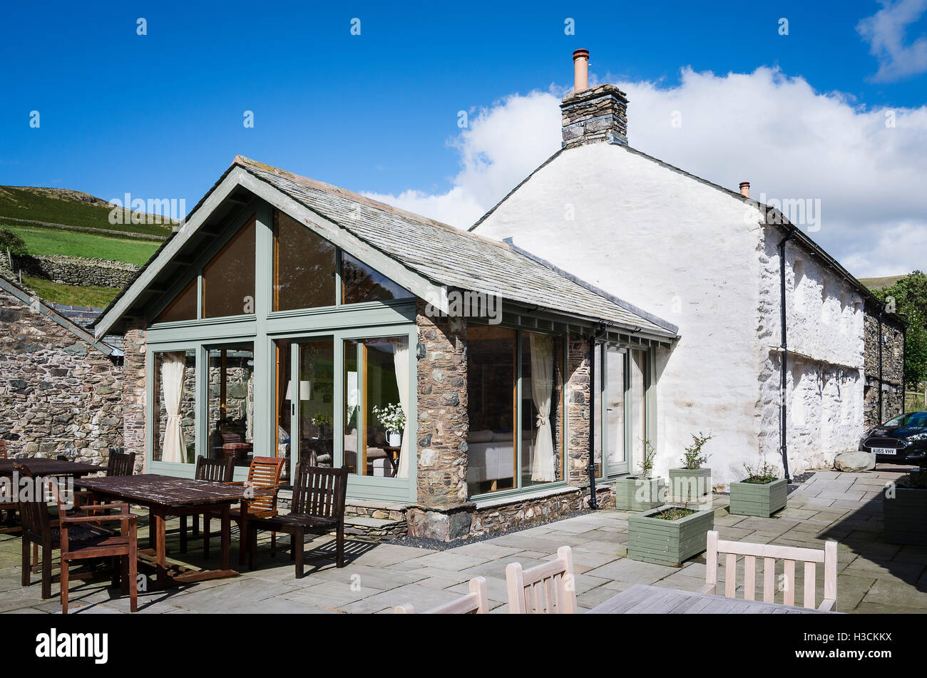 Hause Hall farm and modern conservatory used as a holiday letting in the English Lake Districtg - Stock Image