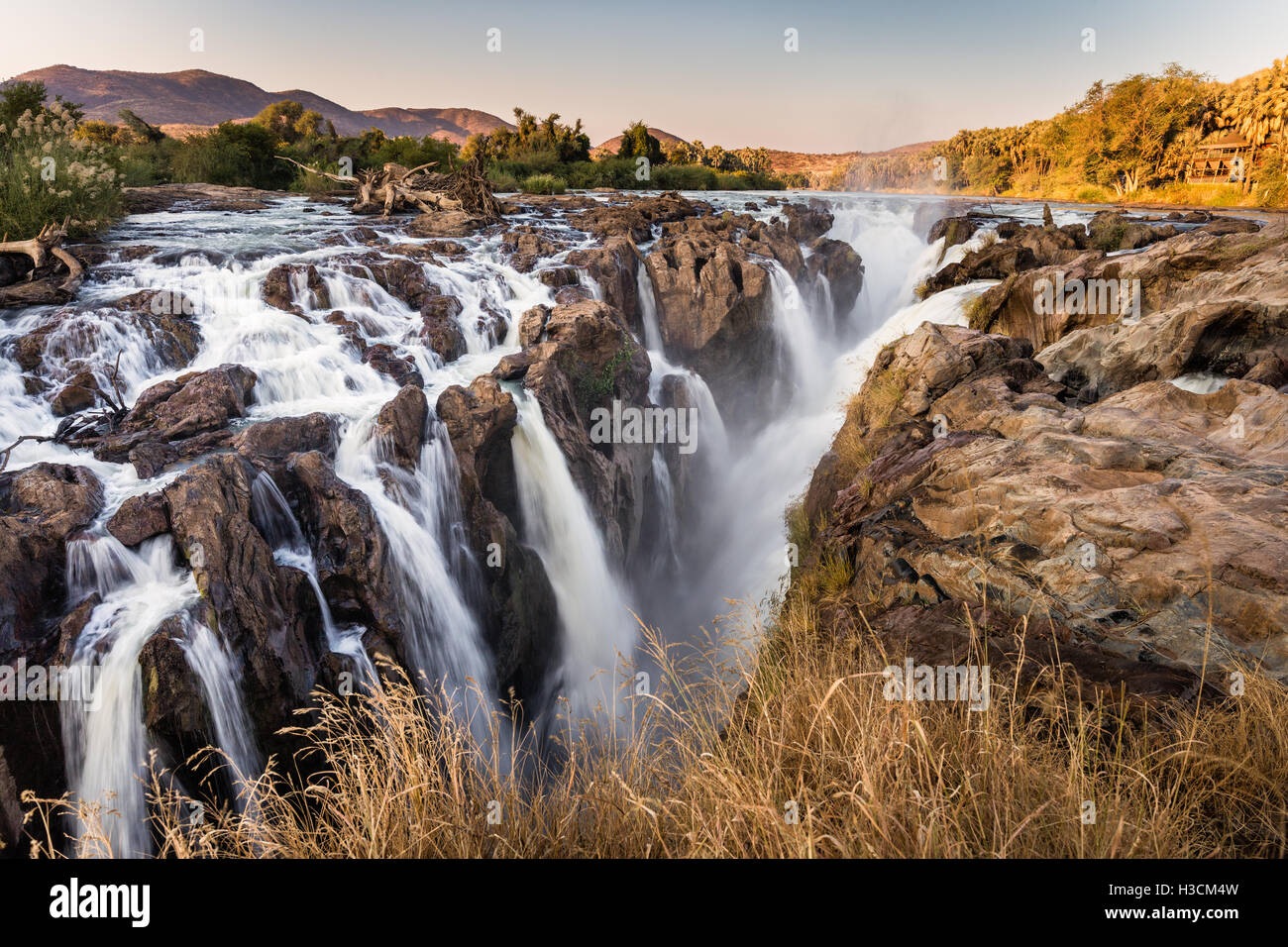Multiple streams comprise the Epupa falls, on the Kunene river in the Kaokoveld of Northern Namibia, on the border - Stock Image