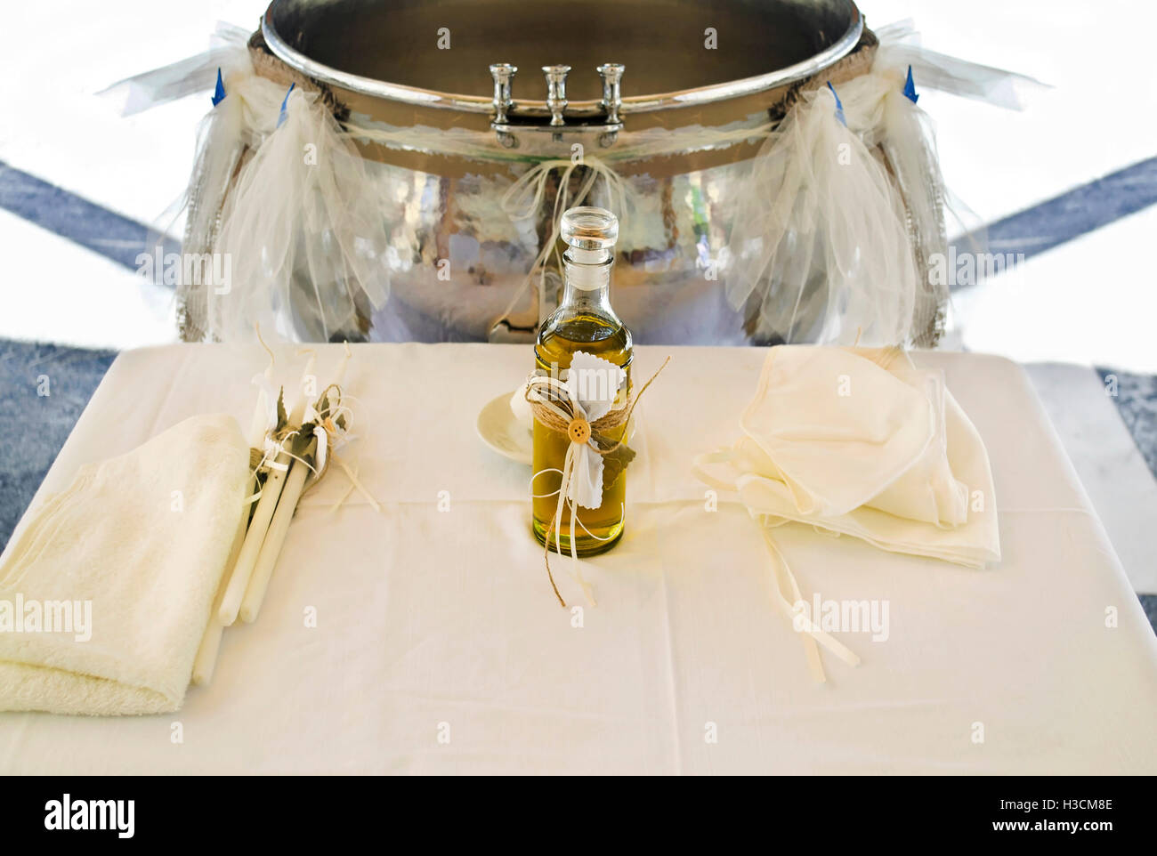 Orthodox Christening oil with candles Greece - Stock Image