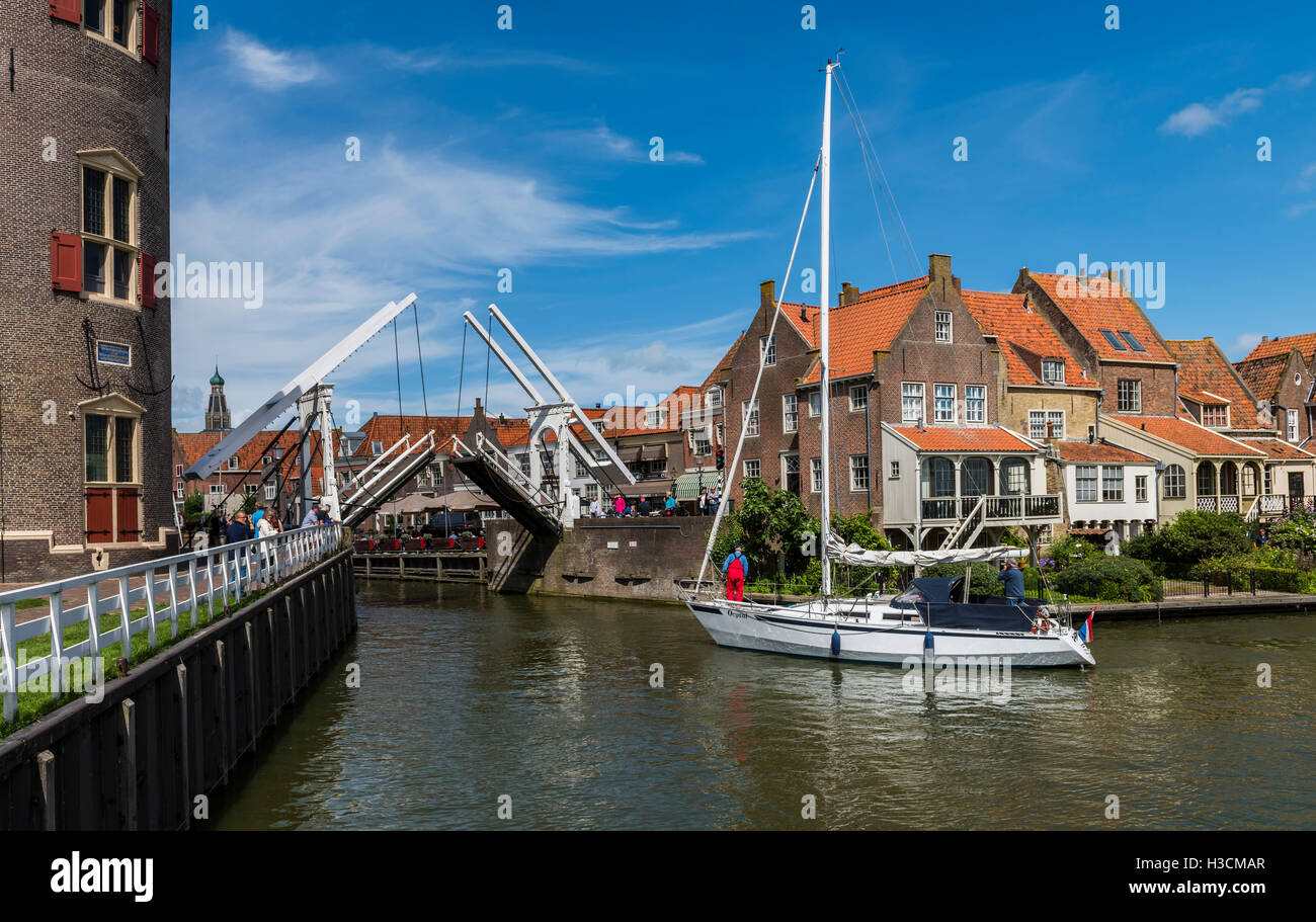 Enkhuizen, The Netherlands - August 9, 2016:  saling ship at the draw bridge in the harbor of touristic Enkhuizen - Stock Image