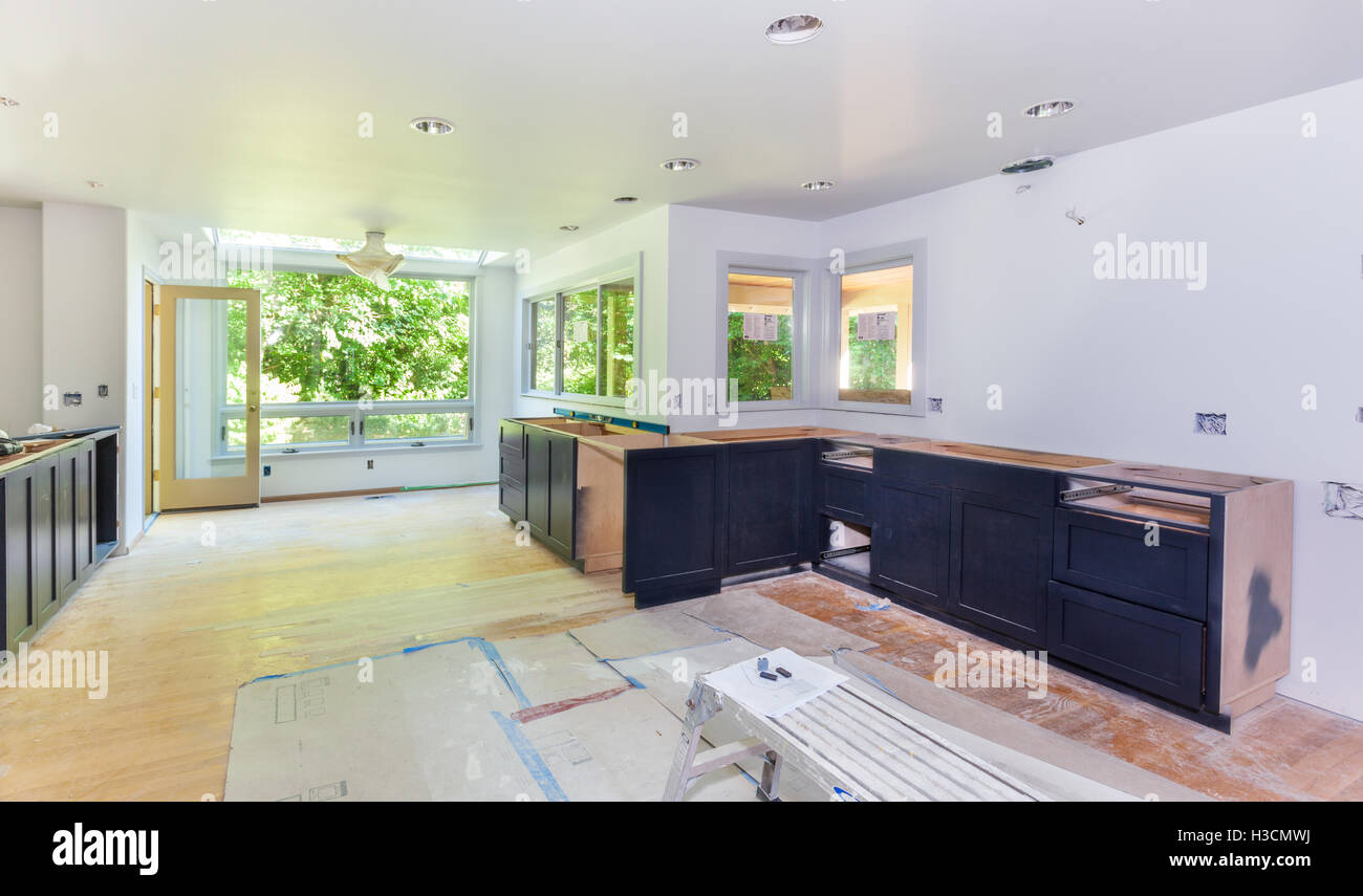 Kitchen cabinet installation - Stock Image