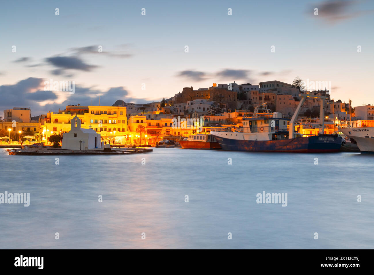 View of the Naxos town and its harbour. - Stock Image