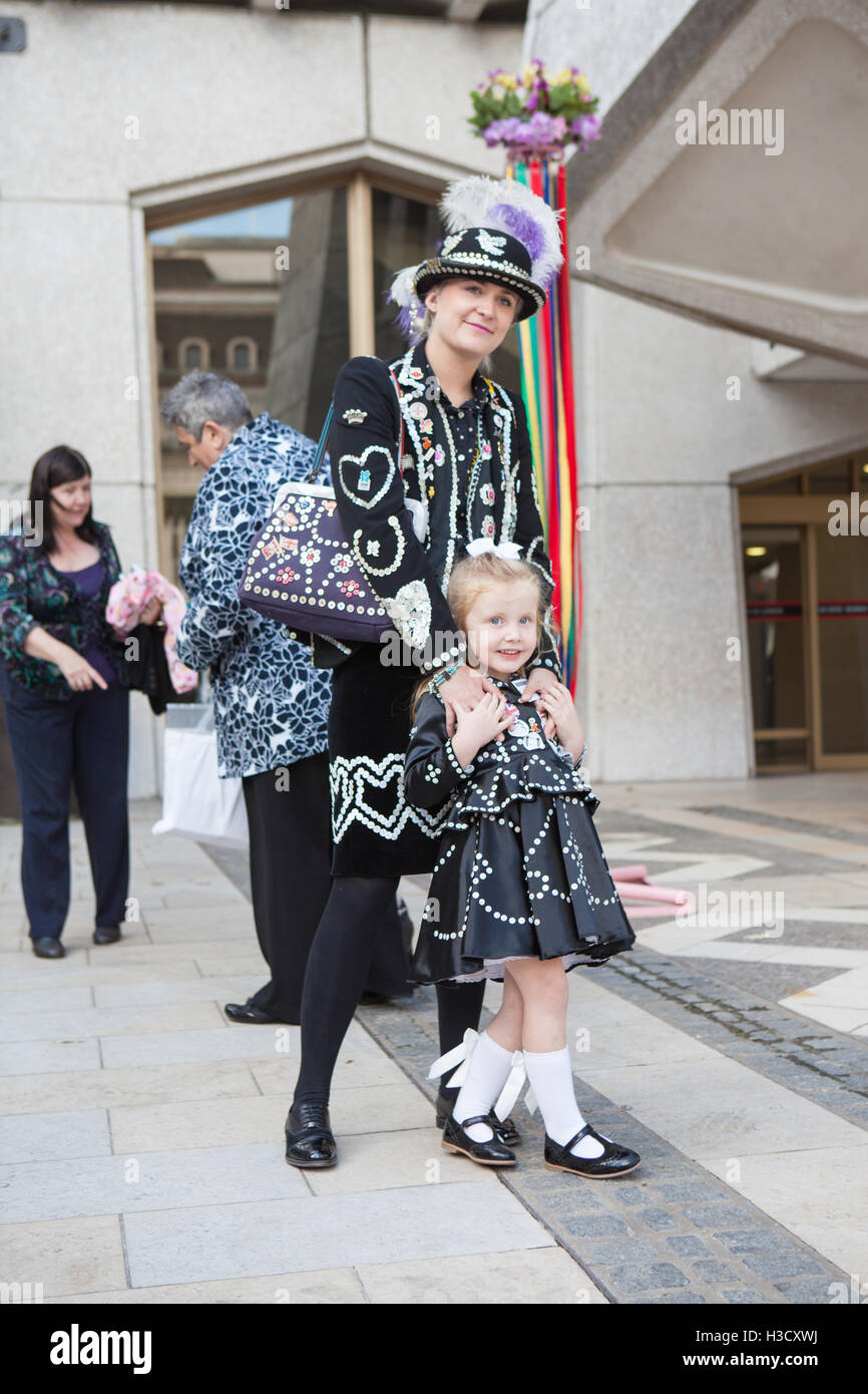 The Annual Pearly Kings and Queens & Costermongers Harvest Festival Held At The Guildhall, London, UK - Stock Image