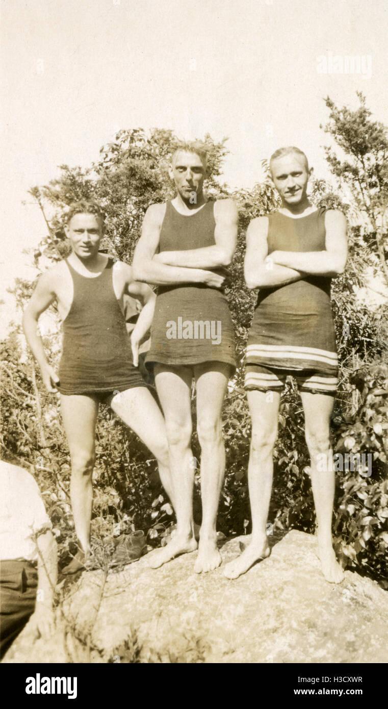 Antique c1925 photograph, three men in 1920s style swim suits. SOURCE: ORIGINAL PHOTOGRAPHIC PRINT. - Stock Image