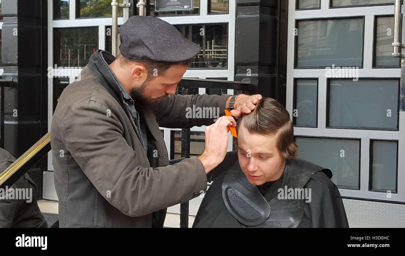 Joshua Coombes cuts the hair of homeless 11-year-old Junior
