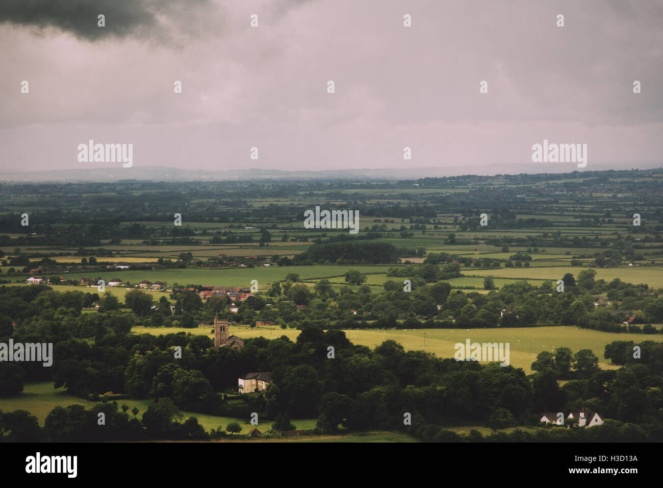 View over a church in the Chilterns, Buckinghamshire, England Vintage Retro Filter. - Stock Image