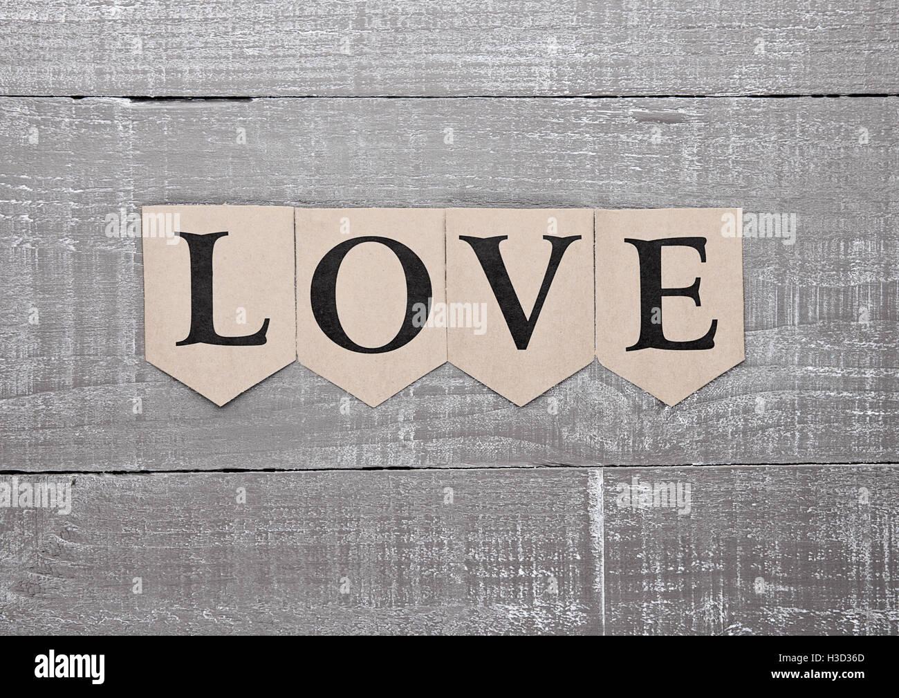 Love letter symbol on wooden board feelings card for present - Stock Image