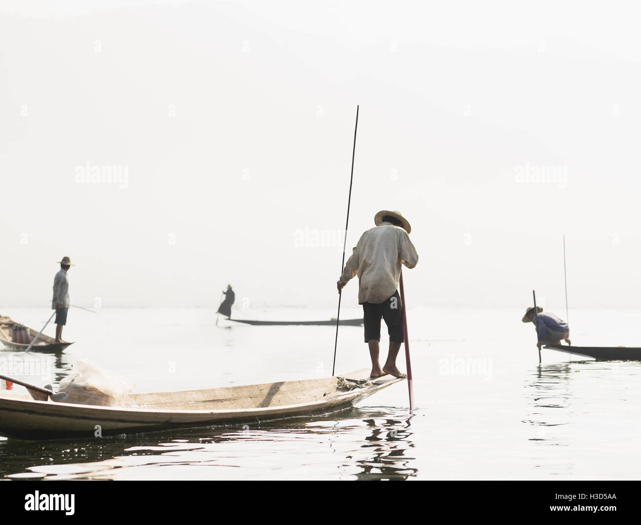 A group of fisherman in a fishing village in Inle Lake, Myanmar (Burma). This village is only accessible by boat. - Stock Image
