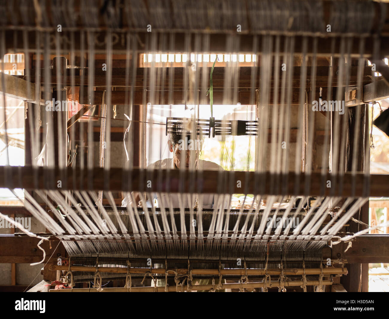 A silk weaver in Inle Lake, Myanmar - Stock Image