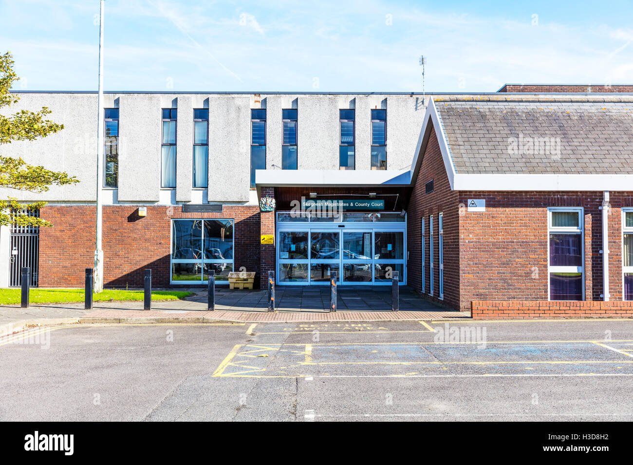 Skegness magistrates and county court magistrate court building exterior front sign signs name buildings entrance - Stock Image