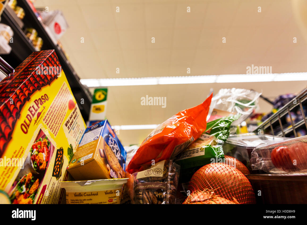 Groceries in shopping cart in supermarket trolley food shopping in trolley shop store grocers supermarkets goods - Stock Image