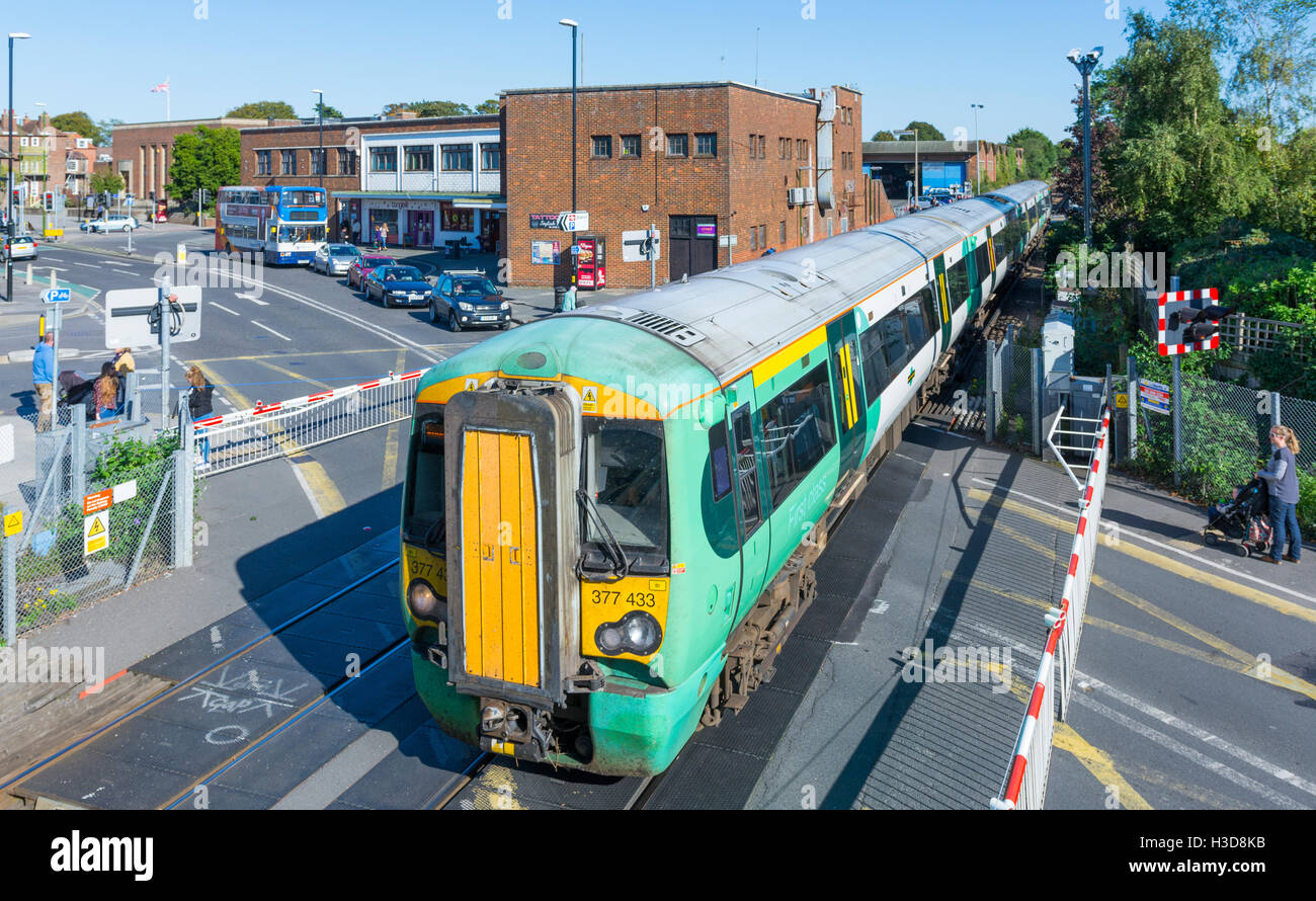 Southern Railway Class 377 Electrostar train on a level crossing at Chichester, West Sussex, England, UK. Southern - Stock Image
