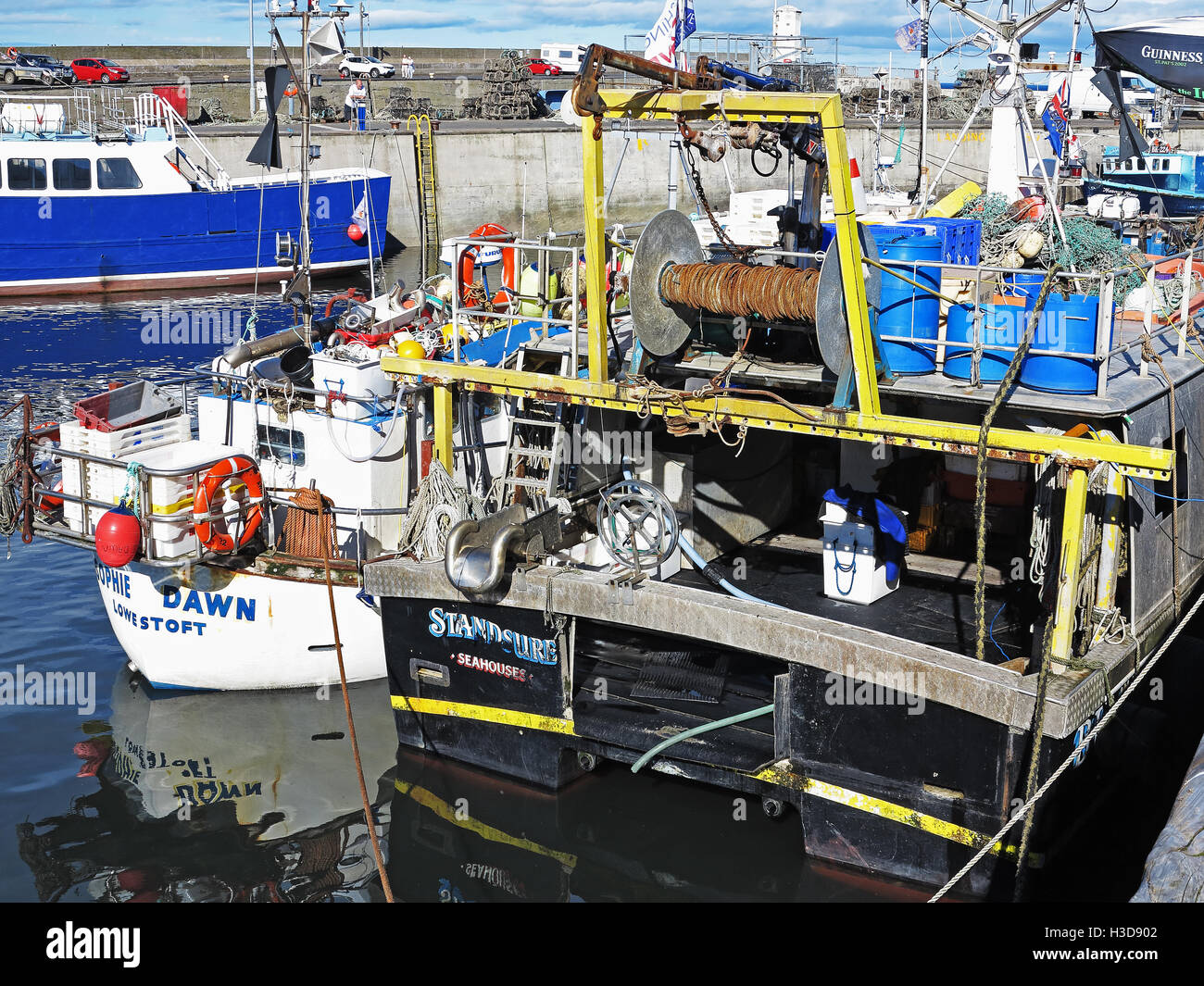 the bustling harbour of Seahouses, Northumberland - Stock Image