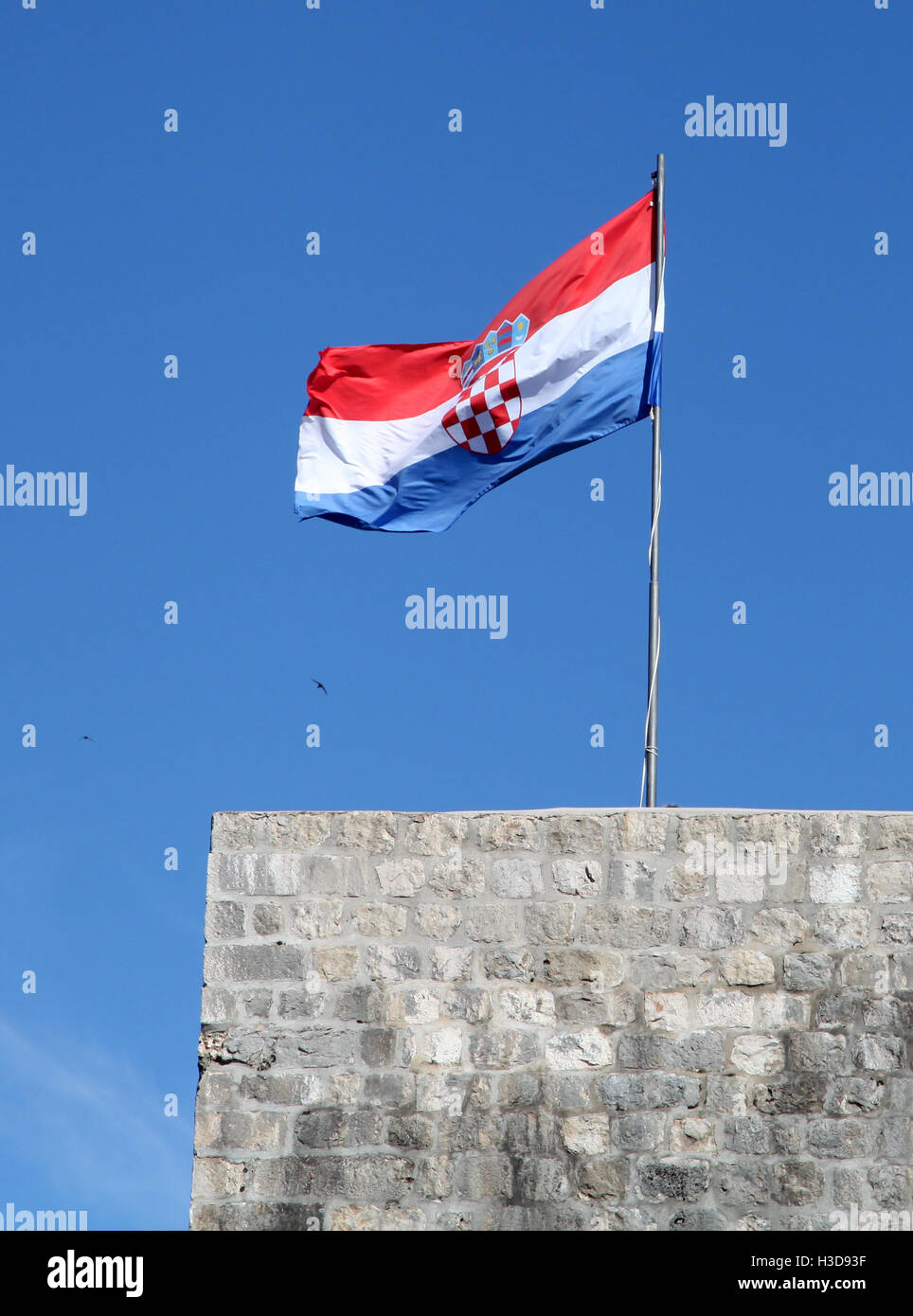Croatia flag on pole at a tower - Stock Image