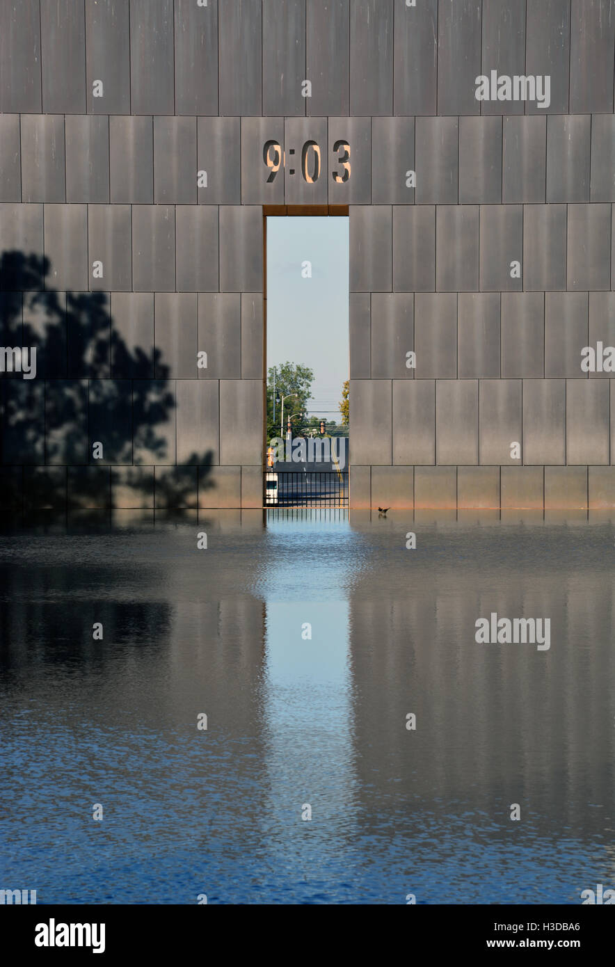 Two gates at the Oklahoma City National Memorial mark before (9:01) and after (9:03) the bombing of the Murrah Federal Stock Photo