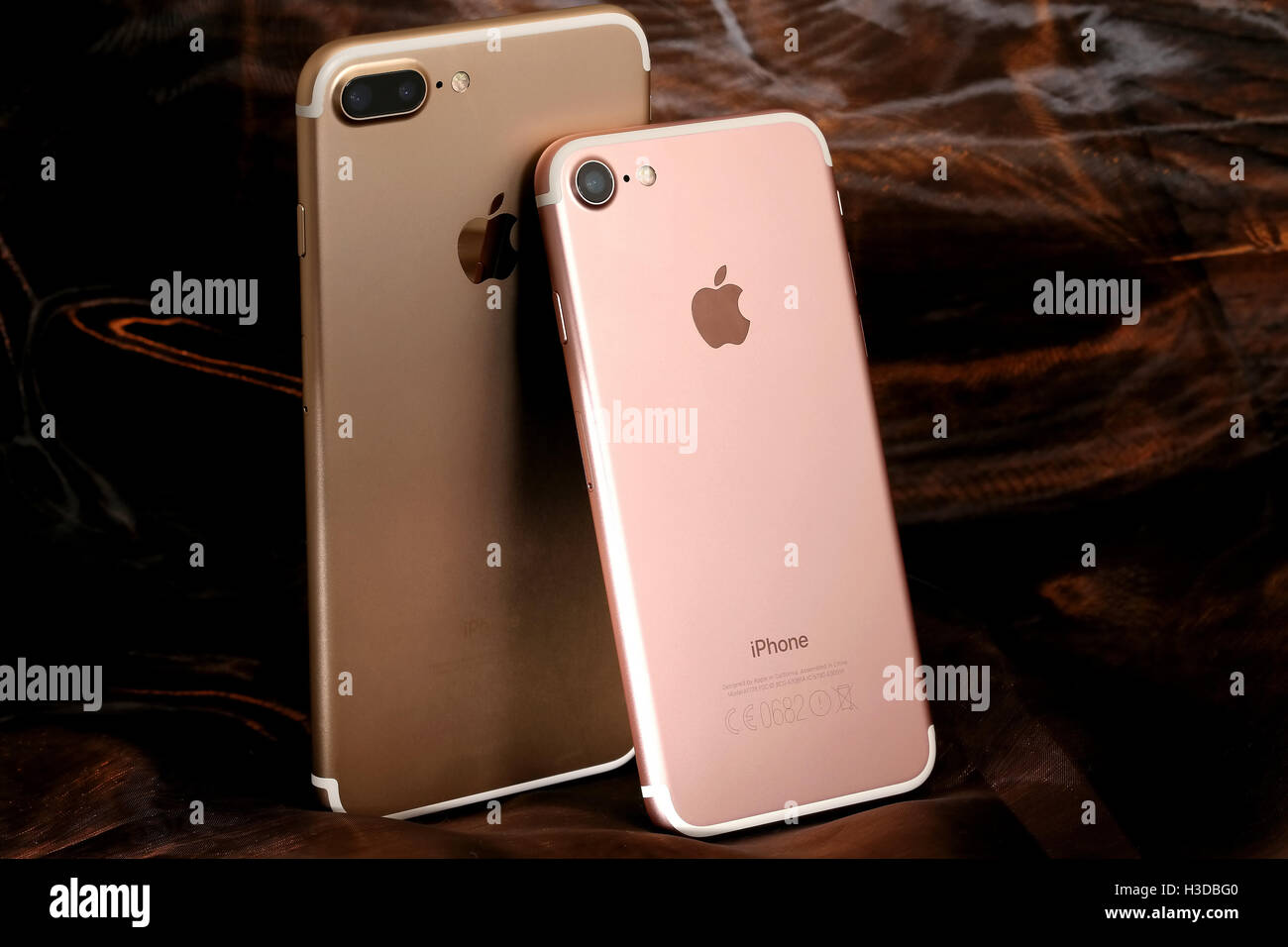 Golden iPhone 7 Plus and pink iPhone 7 - Stock Image