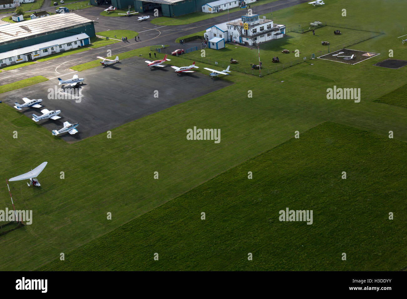 Wolverhampton Halfpenny Green in South Staffordshire, England. Aerial view showing control tower and parked aircraft. - Stock Image