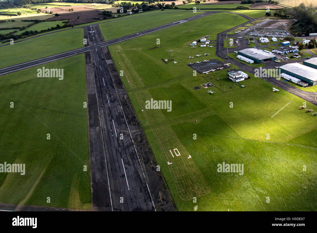 Wolverhampton Halfpenny Green in South Staffordshire, England. Aerial view showing runway, hangars and light aircraft. - Stock Image