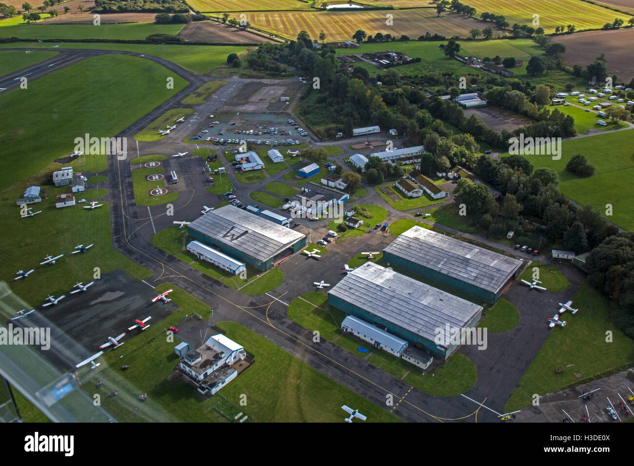 Wolverhampton Halfpenny Green in South Staffordshire, England. Aerial view showing hangars and light aircraft. - Stock Image