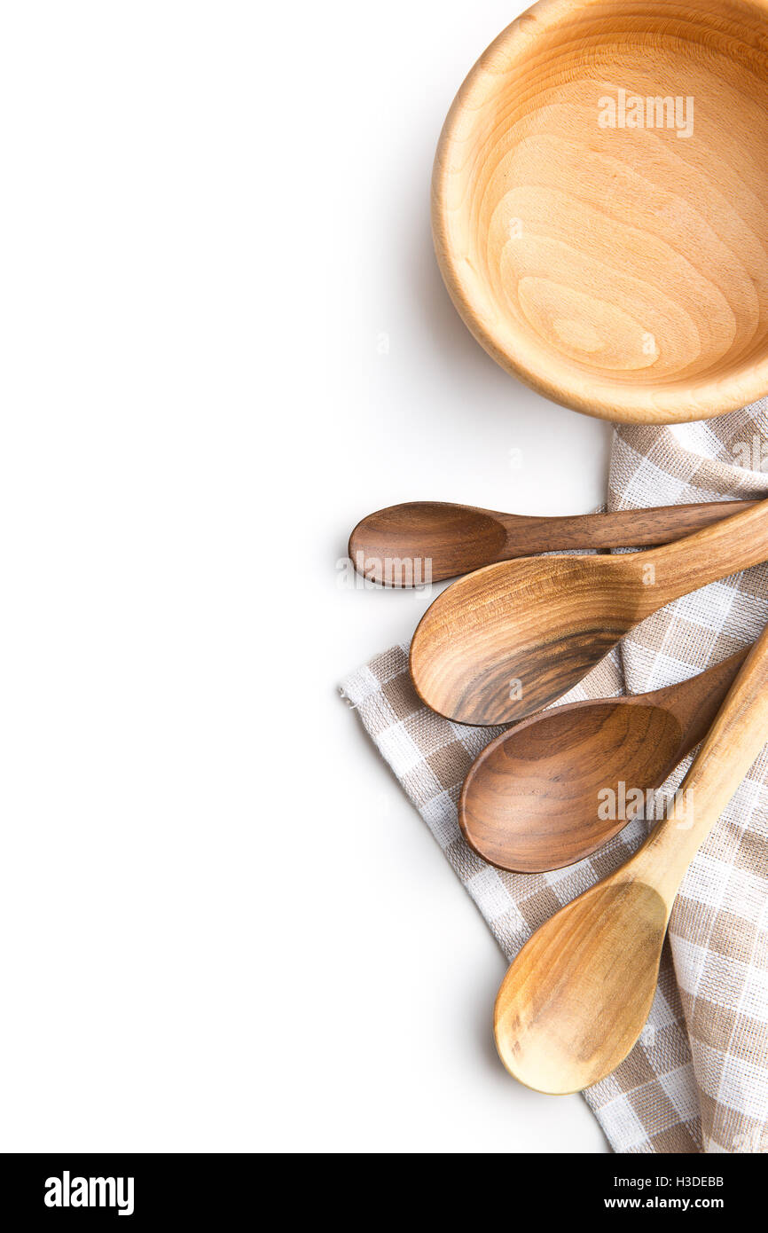 Handmade wooden spoons and wooden bowl isolated on white background. Top view. - Stock Image