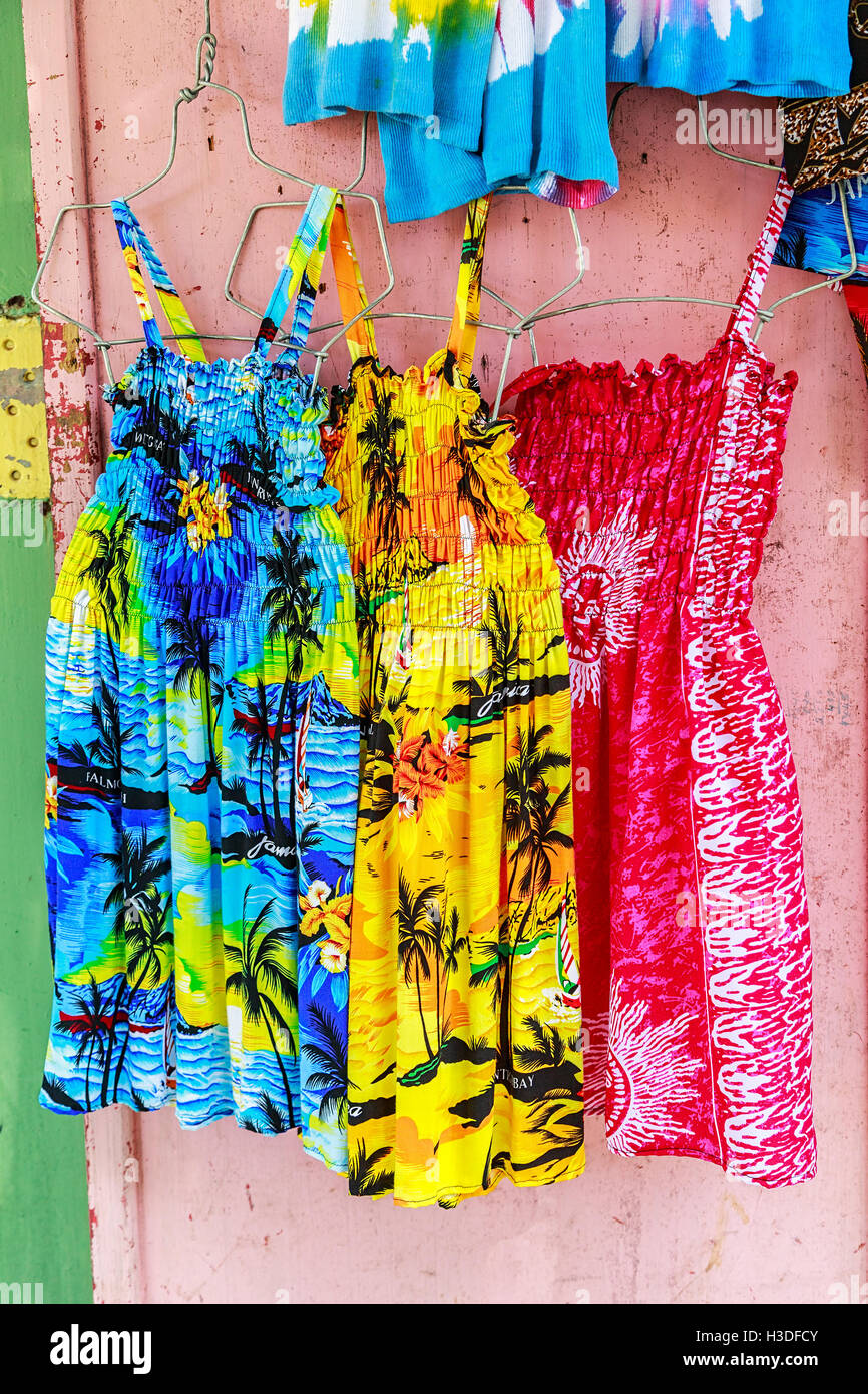 Tropical dresses in a Caribbean market. - Stock Image