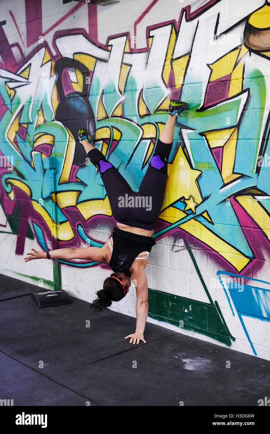 A Female Athlete Trains In Crossfit Gym