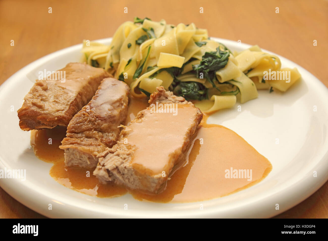 Veal roast with Tagliatelle noodles Stock Photo