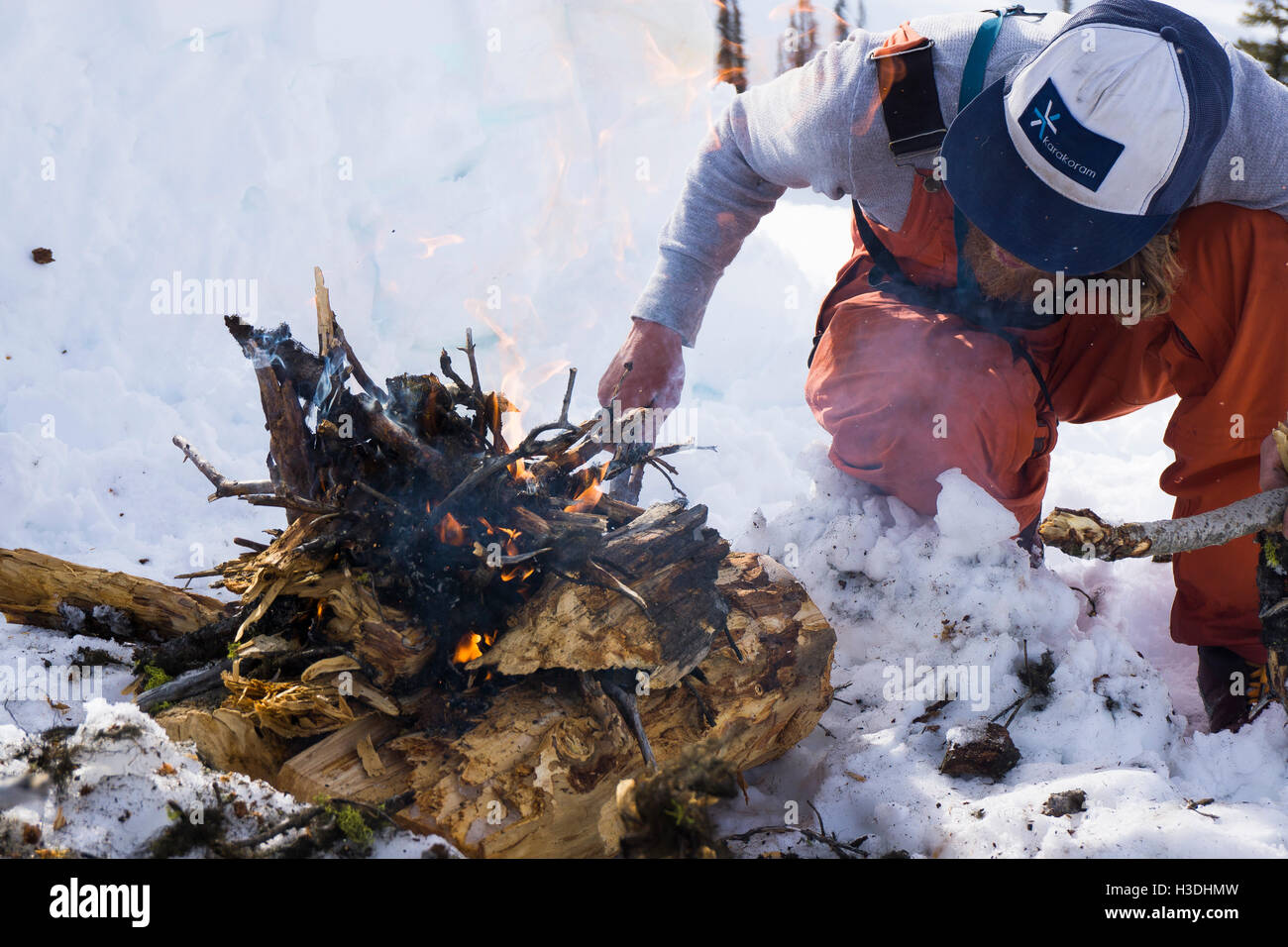 Building a fire during the winter in the backcountry - Stock Image
