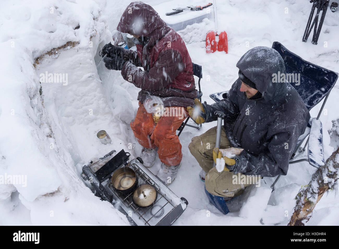 Cooking breakfast during a snow storm - Stock Image