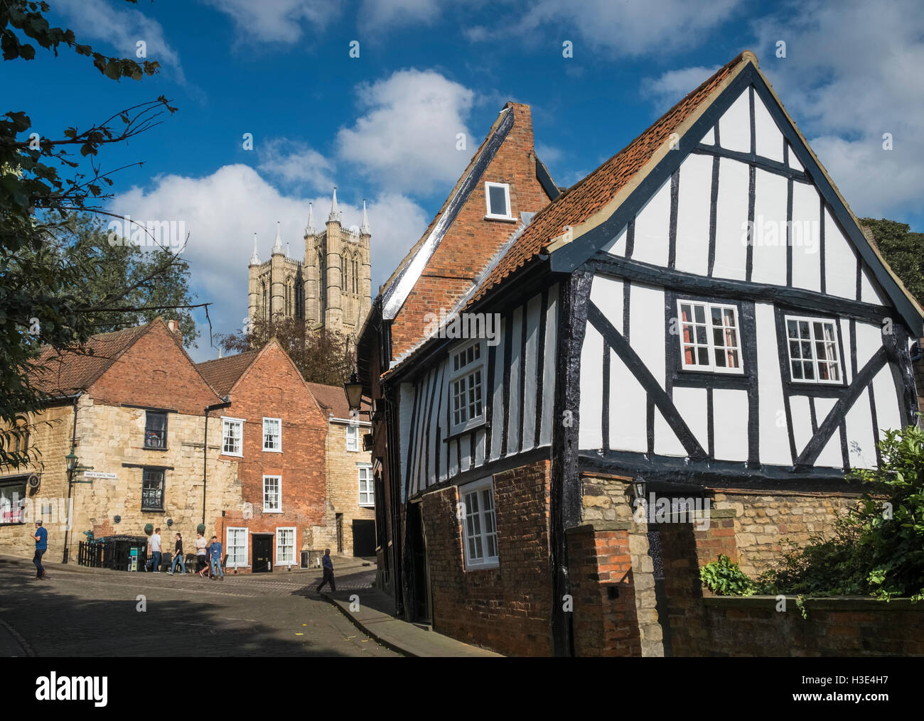 Historic buildings near Steep Hill, Lincoln, featuring half timbered cottage on Michaelgate, and Lincoln Cathedral - Stock Image