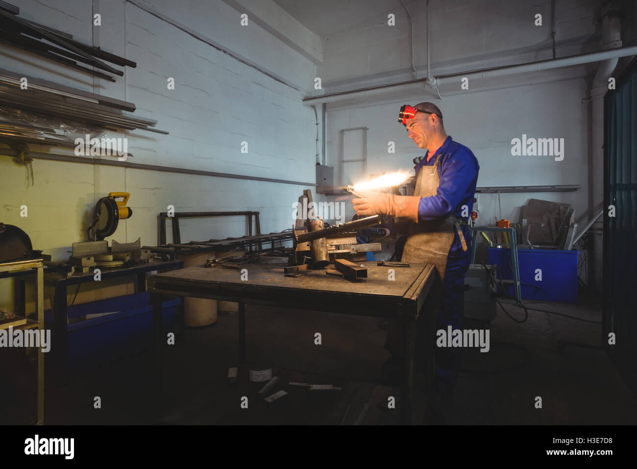 Male welder holding welding torch - Stock Image