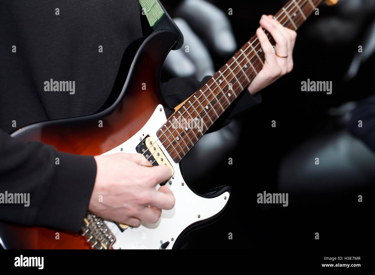 A Young Musician Playing Electric Guitar Close Up Stock Photo