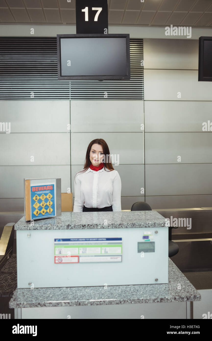 Portrait of airline check-in attendant - Stock Image