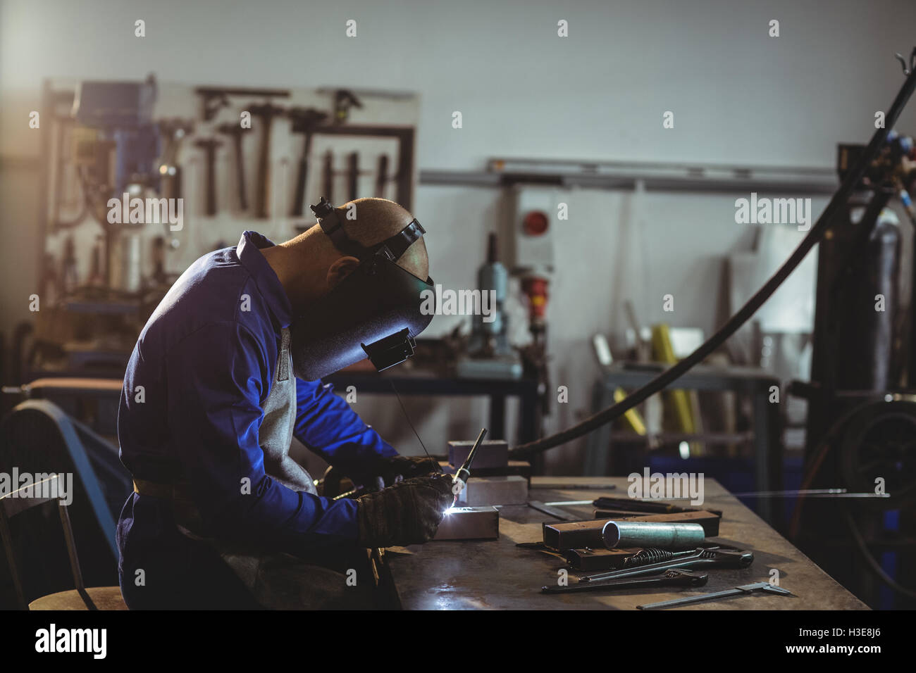 Male welder working on a piece of metal Stock Photo