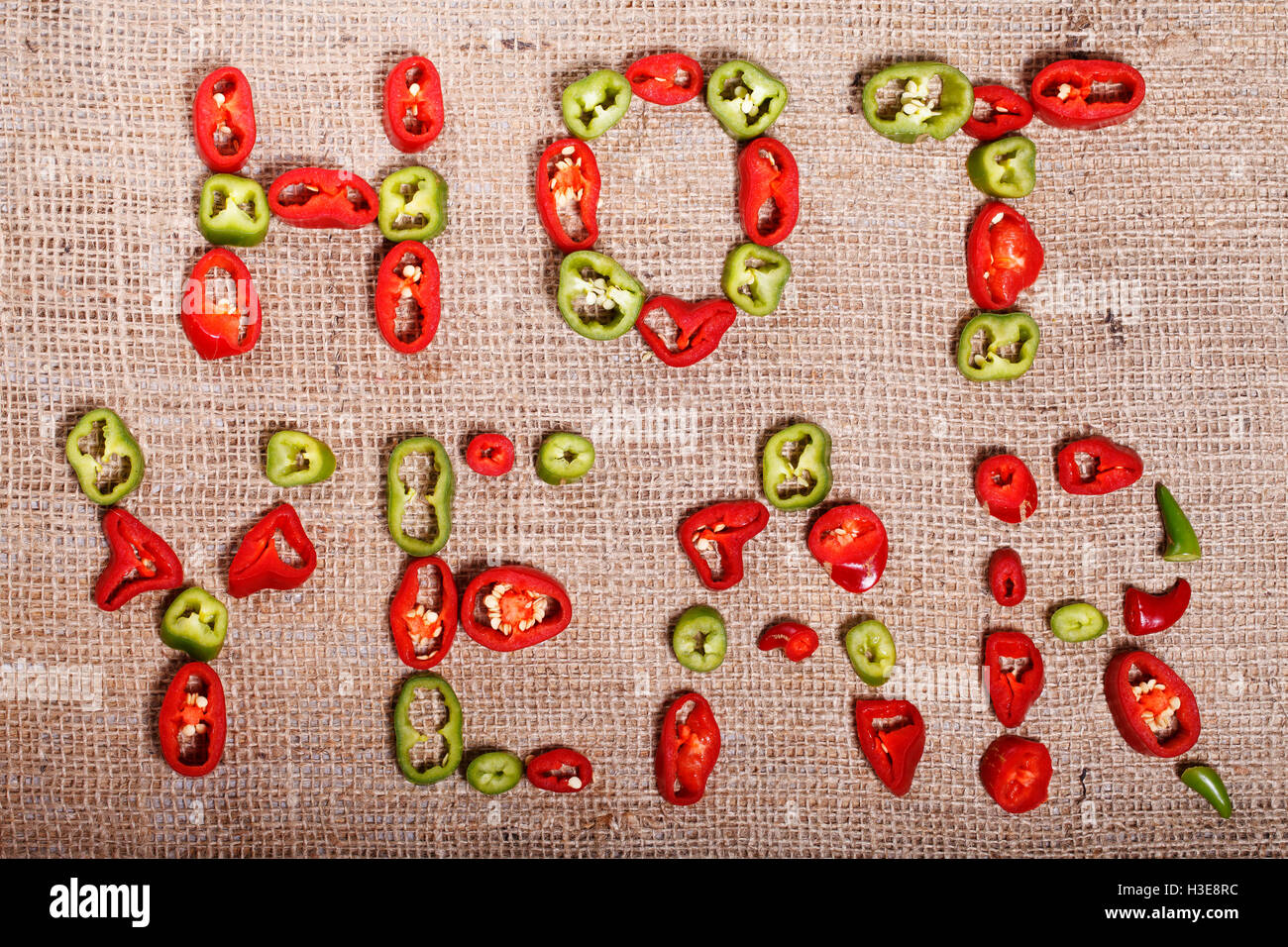 Hot year, events and travel in the new year, abstract background with hot peppers - Stock Image