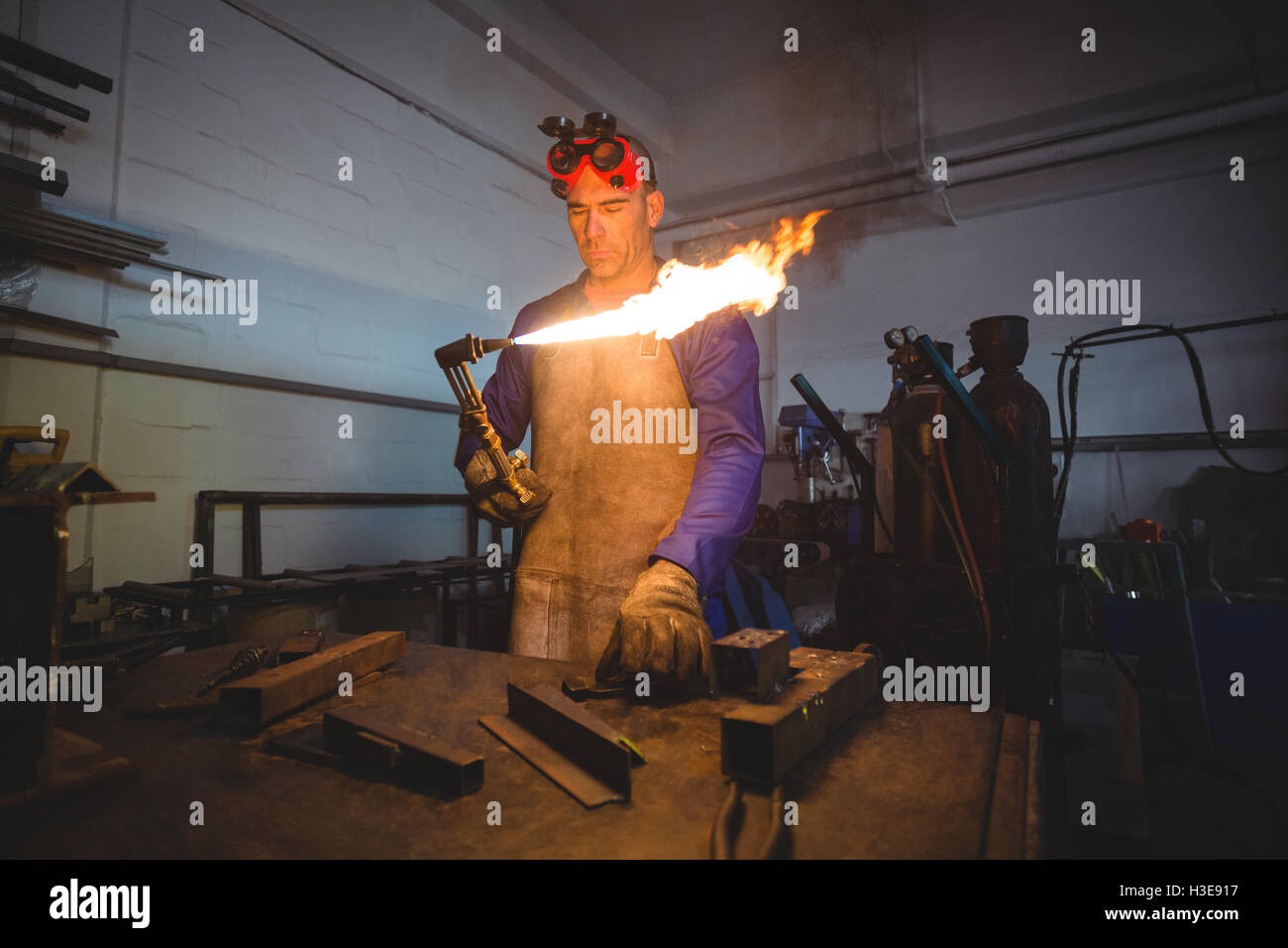 Male welder holding welding torch - Stock Image